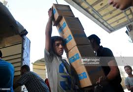 unicef siege a syrian youth carries boxes of aid donated by unicef in the rebel