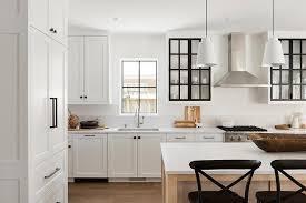oak kitchen cabinets with glass doors black stools at beige oak island transitional kitchen