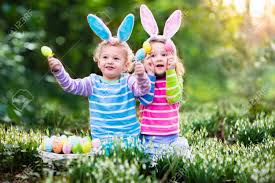 kids easter kids on easter egg hunt in blooming garden children with