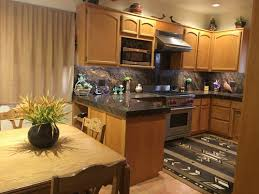 what color should cabinets be in a small kitchen need help on paint color and sheen for kitchen cabinets