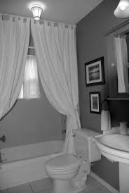 gray wall paint white curtain mirror without frame glass window