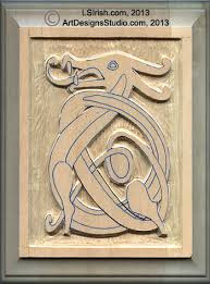 wood carving a celtic dragon knot pattern by lora s irish
