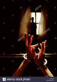 handcuffed to bed a woman is handcuffed to a brass bed reaching for help stock