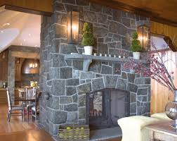 electric fireplace with gray stone panel surround among wooden