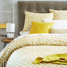 glorious bedroom with diaper pattern yellow and gray bedding