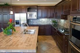 small u shape kitchen decoration using brown travertine tile