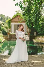 a watters wedding dress and maids in navy blue for a handmade and