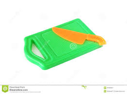 plastic toy green chopping board and orange knife stock photo