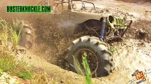 monster truck mud bogging videos mega mud trucks going deep busted knuckle films