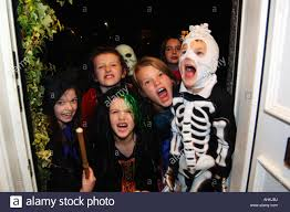 halloween trick or treat children knock on doors asking for sweets