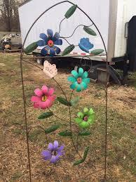 wrought iron colorful flower trellis vine growing yard art
