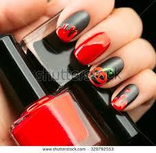 Halloween Nail Art Pumpkin - halloween nail art design nail polish stock photo 328792553