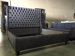 upholstered wingback bed in charcoal velvet with diamond tufting