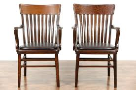 sold pair 1910 antique oak banker or office chairs leather
