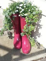 diy rainboot planter the cutest way to add a pop of color to