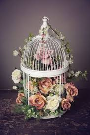 Decorative Bird Cages For Centerpieces by Wedding Flowers In White Bird Cage Kinda Has A Rustic Feel To It