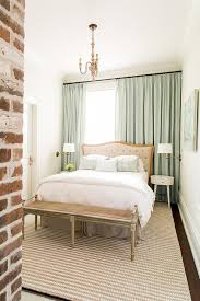 white cane headboard and bamboo nightstand cottage bedroom