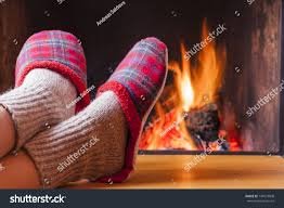 relaxing fireplace on winter evening stock photo 144573008