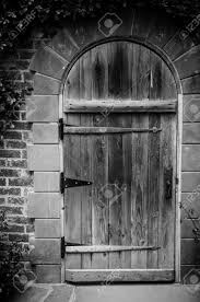 thanksgiving point photography black and white image of classic door and arch in italian garden