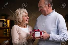 elderly gifts of an elderly exchanging gifts stock photo picture