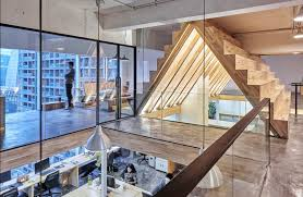 stepped roof creates dramatic office space freshome com collect this idea 9