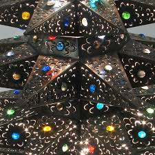 lighted punched tin tree with marbles aged tin