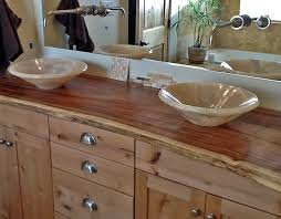 onyx vessel sinks on natural edge wood slab vanity top bathroom
