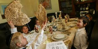 passover seder for children children sit around the table and simulate the passover seder photo