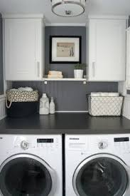 small gray laundry room home with baxter featured on