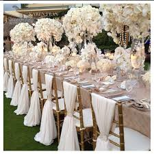 white wedding chairs blush and white wedding reception with gold touches