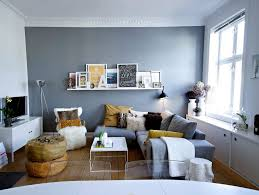 living room black console table gray sofa white bookcases brown