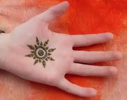 awesome green colored henna sun on tattoos photos