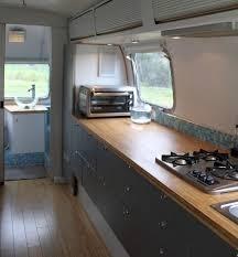 Vintage Galley Kitchen - cook on the road sleek kitchen in a vintage airstream kitchn