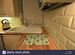 A Kitchen Sink Worktop Cupboards And Tiles Stock Photo Royalty - Kitchen sink cupboards