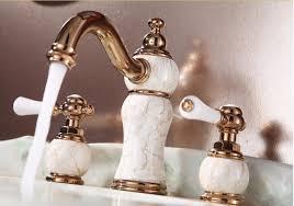 widespread gold bathroom sink faucet