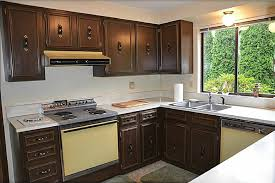 are brown kitchen cabinets outdated before and after a stunning two toned kitchen remodel