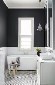 patterned black and white tiles on the floor is a great addition to this mid
