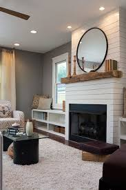 we gave a builder basic mantel and fireplace a much needed facelift we went big and bold with shiplap painted stones and a rustic mantel box