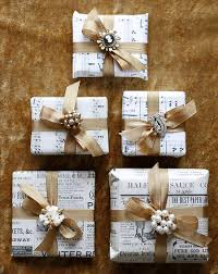 sheet music wrapped gifts with brooches winter wedding diy thrifty
