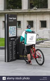 Seeking Manchester City Map In Crown Square In Manchester With Deliveroo Cyclist