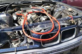 want a trunk mounted battery cable cheap go junkyard shopping