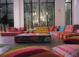 colorful cushions and sofa beside floor lamp in modern