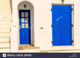 blue door of typical greek house on coast of paros island greece