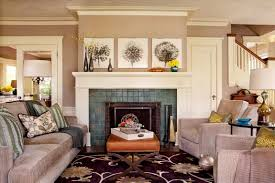 big cozy seats with brown ottoman infront of a fireplace in a