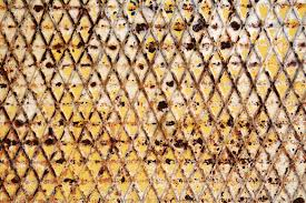 abstract background of an old rusty iron trellis with geometric