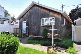 adorable city island cottage offers seaside charm for 399k