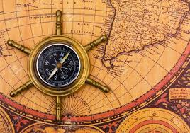 Old World Map A Compass On A Old World Map Background Stock Photo Picture And