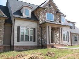 exterior design brick front porch pillar with gaf shingles and