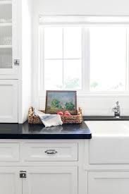 white and taupe lower kitchen cabinets white kitchen cabinets with black countertops are the next