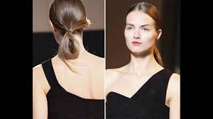 loose and sleek center part ponytail middle parting hairstyle is